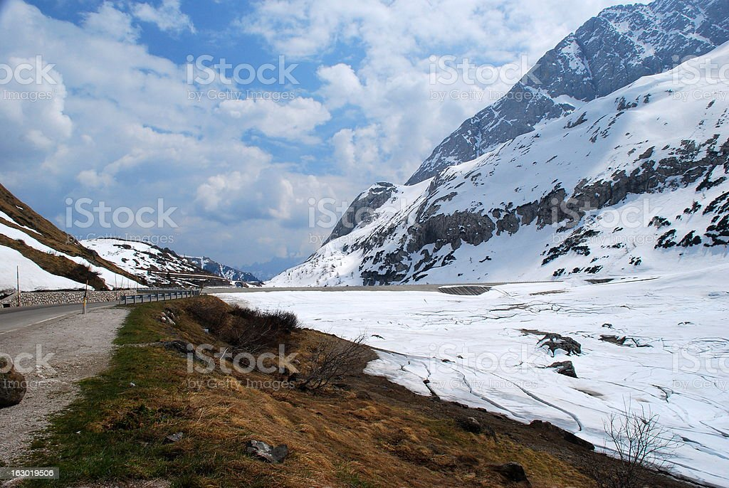Spring Thaw and Snow at the Italian Dolomites stock photo