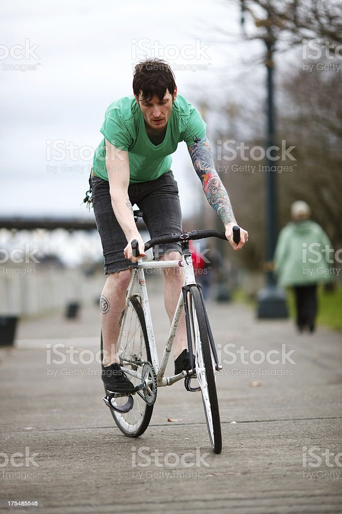 Spring Time Bicycle Riding Young Man on Bike Path stock photo