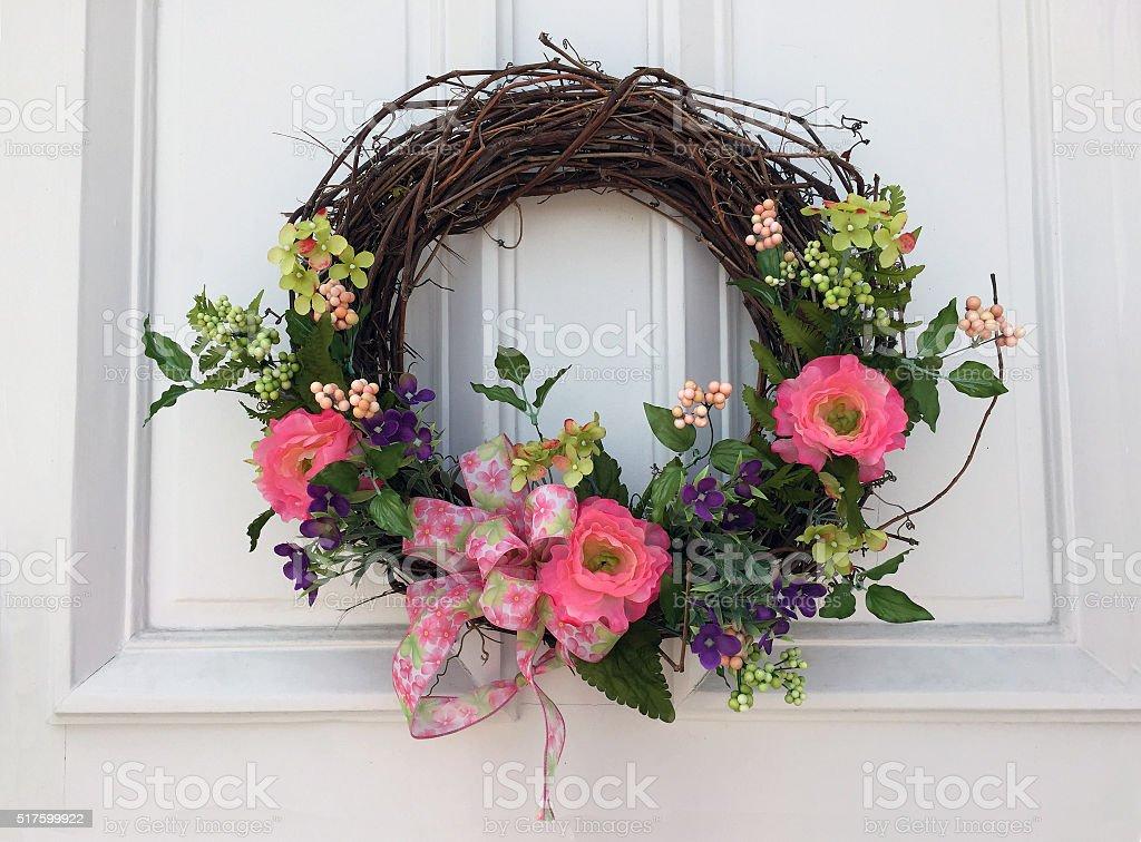 Spring Wreath on a White Door stock photo