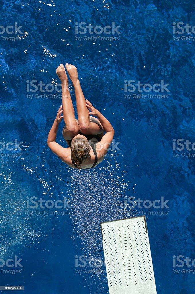 Springboard back dive stock photo