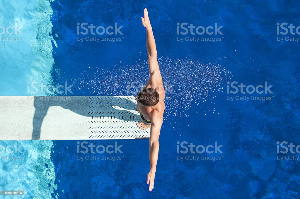 Springboard diving competitor stock photo