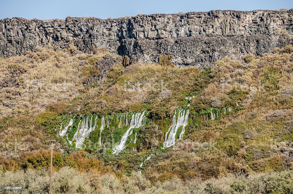 Springs Flowing from a Basalt Bluff stock photo