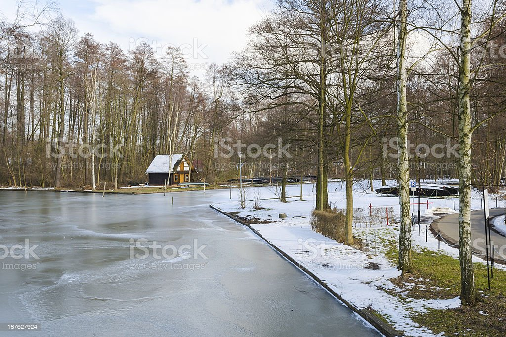 Springtime european park with frozen channel stock photo