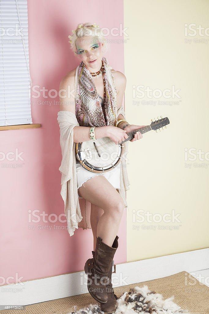 Springtime Hippy Girl Playing Her Banjolele royalty-free stock photo
