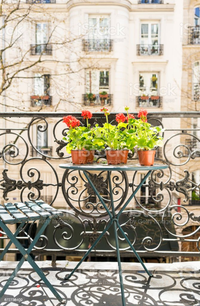 Springtime with red geraniums on a Paris balcony stock photo