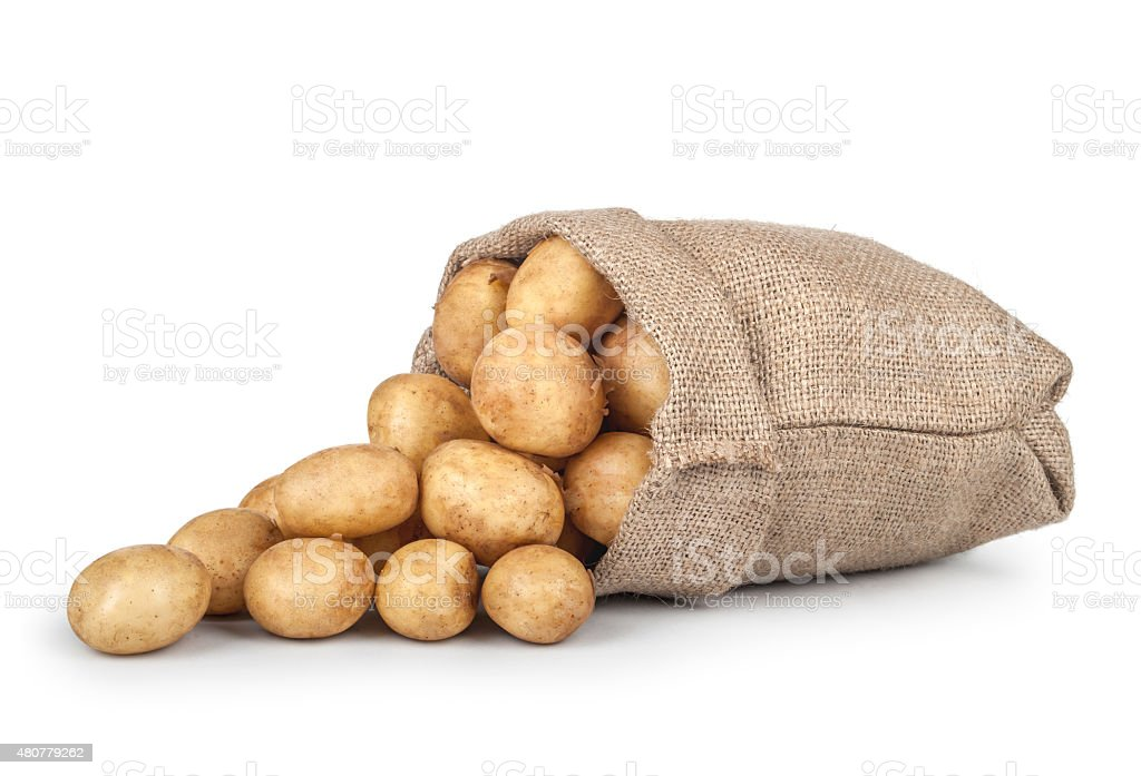 sprinkled new potatoes in the bag isolated on white background stock photo