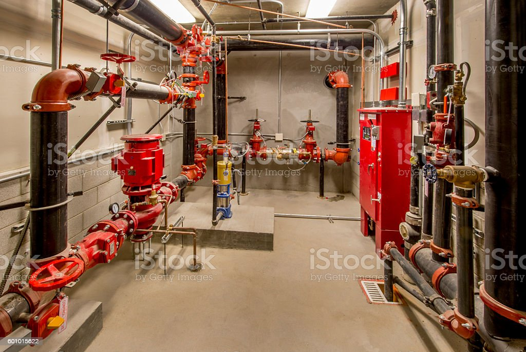 Sprinkler Control Room with Pumps, Valves, and Standpipes stock photo