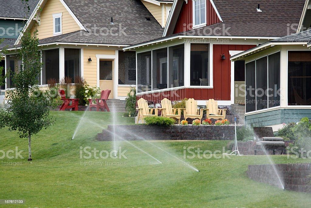 Sprinkler System in a Pretty Residential Community stock photo