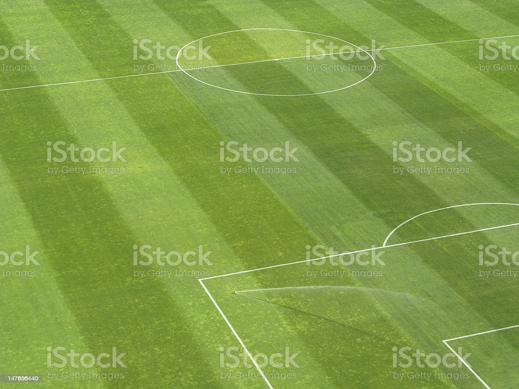 Sprinkler watering soccer field royalty-free stock photo