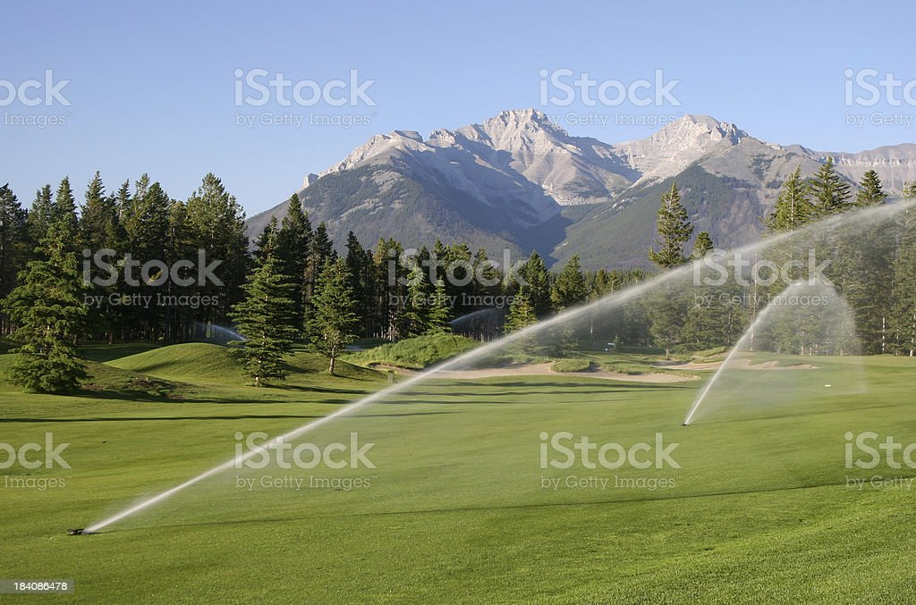 Sprinklers on a Beautiful Mountain Golf Course stock photo
