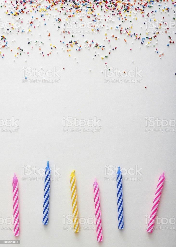 Sprinkles and candles background stock photo