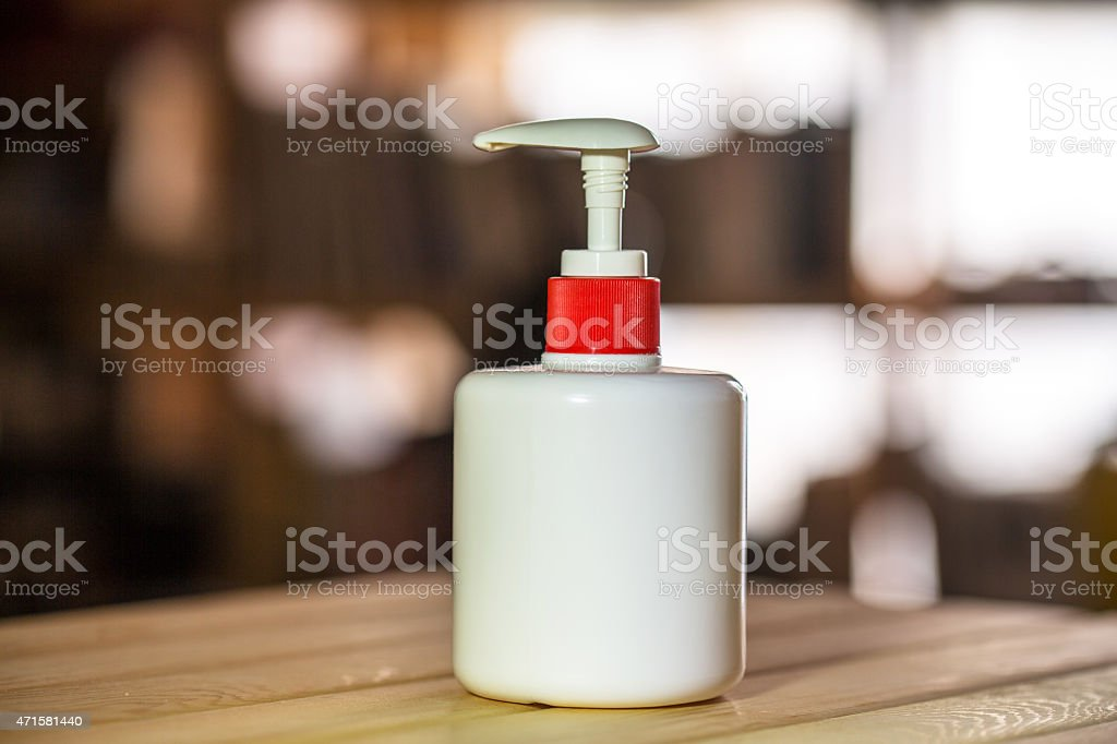 sprinkling bottle on table stock photo