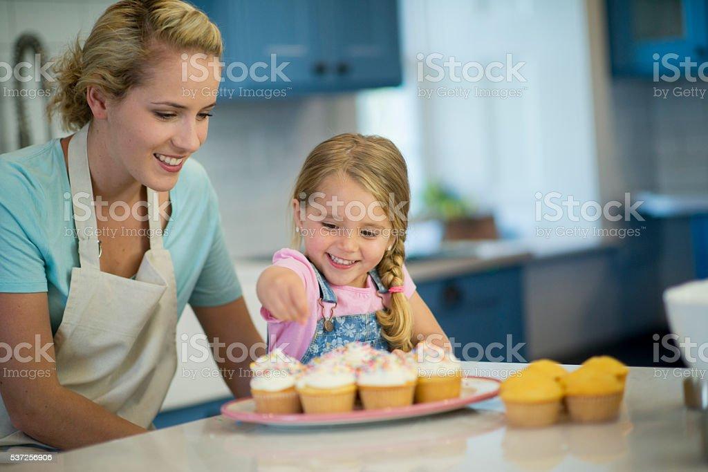Sprinkling Cupcakes stock photo