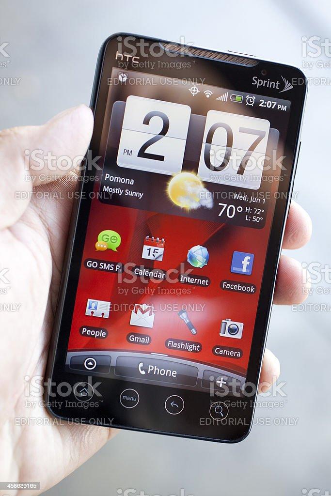 Sprint HTC EVO phone opened on the homescreen. stock photo
