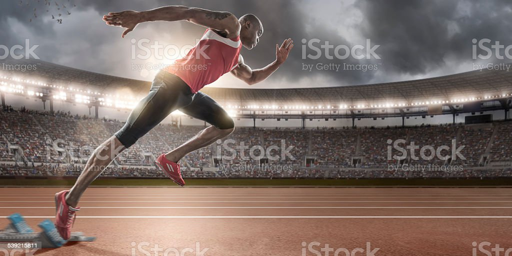 Sprinter Bursting Out of Blocks stock photo