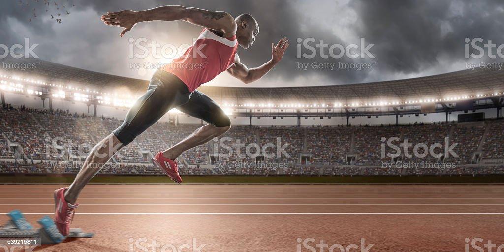 Sprinter Bursting Out of Blocks stock photo