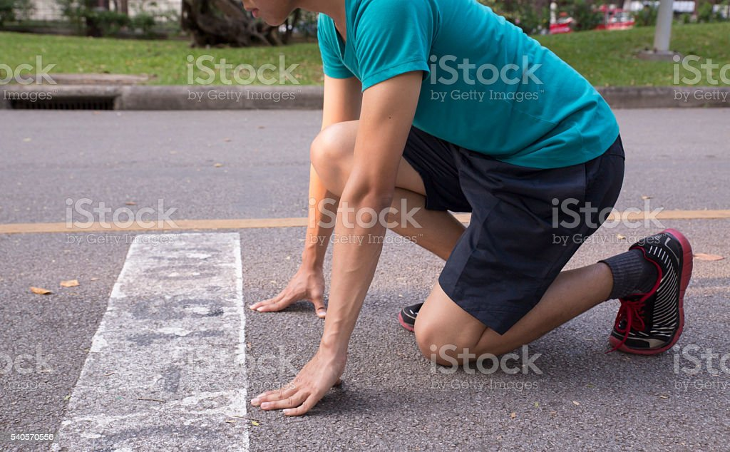 Sprinter getting ready to start the race for running stock photo