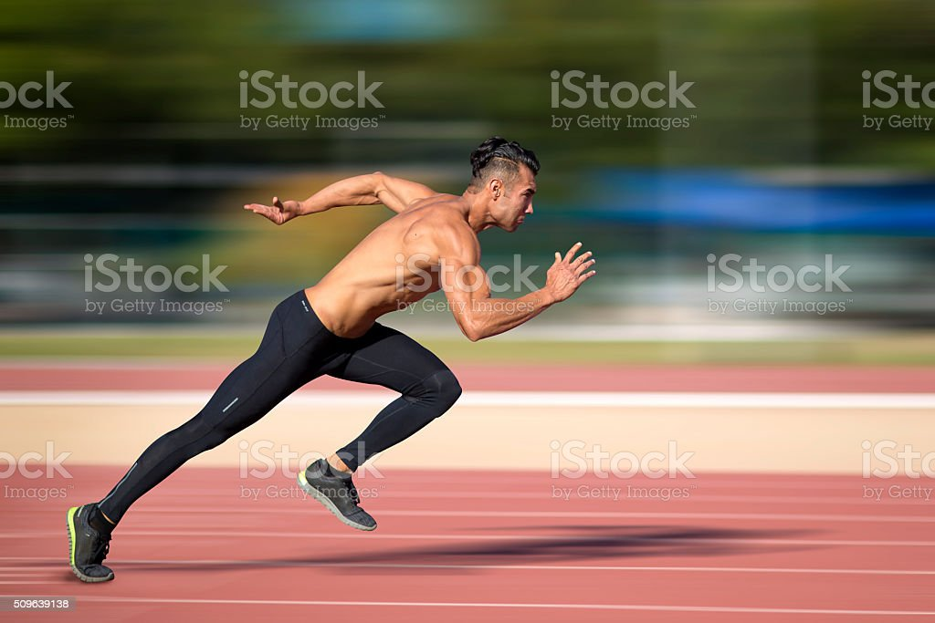 Sprinter leaving  on the running track. stock photo