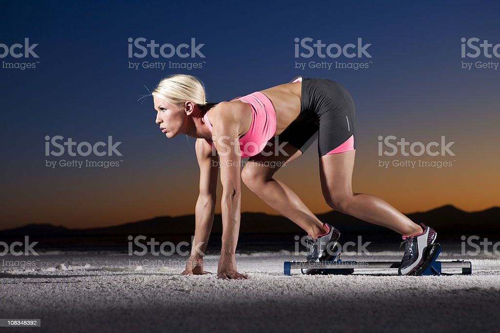 Sprinter Woman at Sunset royalty-free stock photo