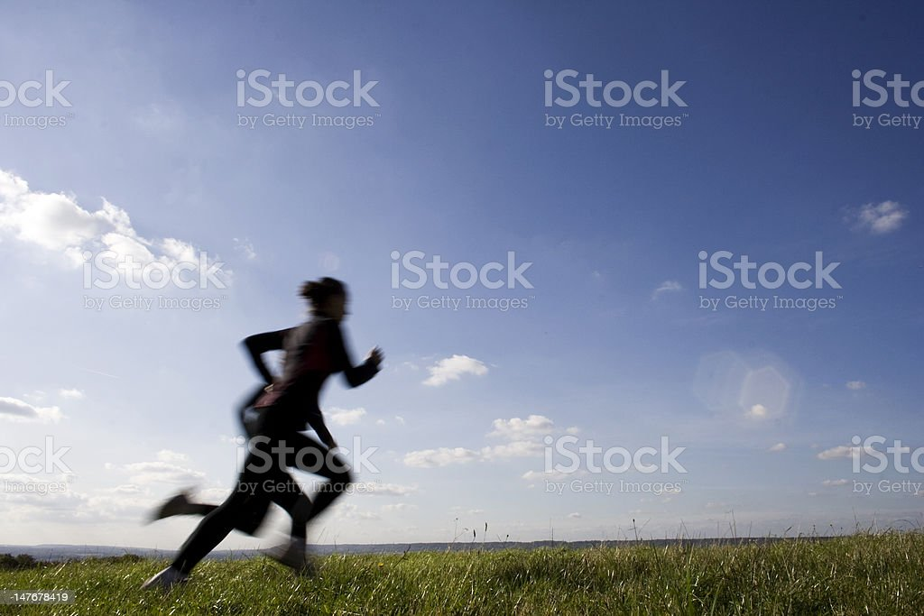 Sprinting across field stock photo