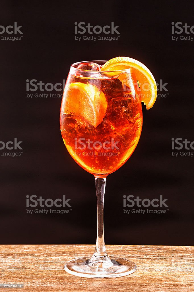 Aperol Spritz in glass, close up on black background stock photo