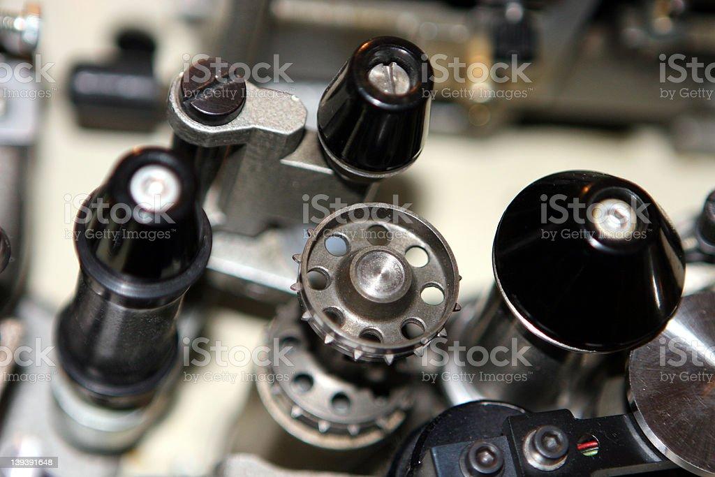 Sprocket wheel on 35mm projector stock photo