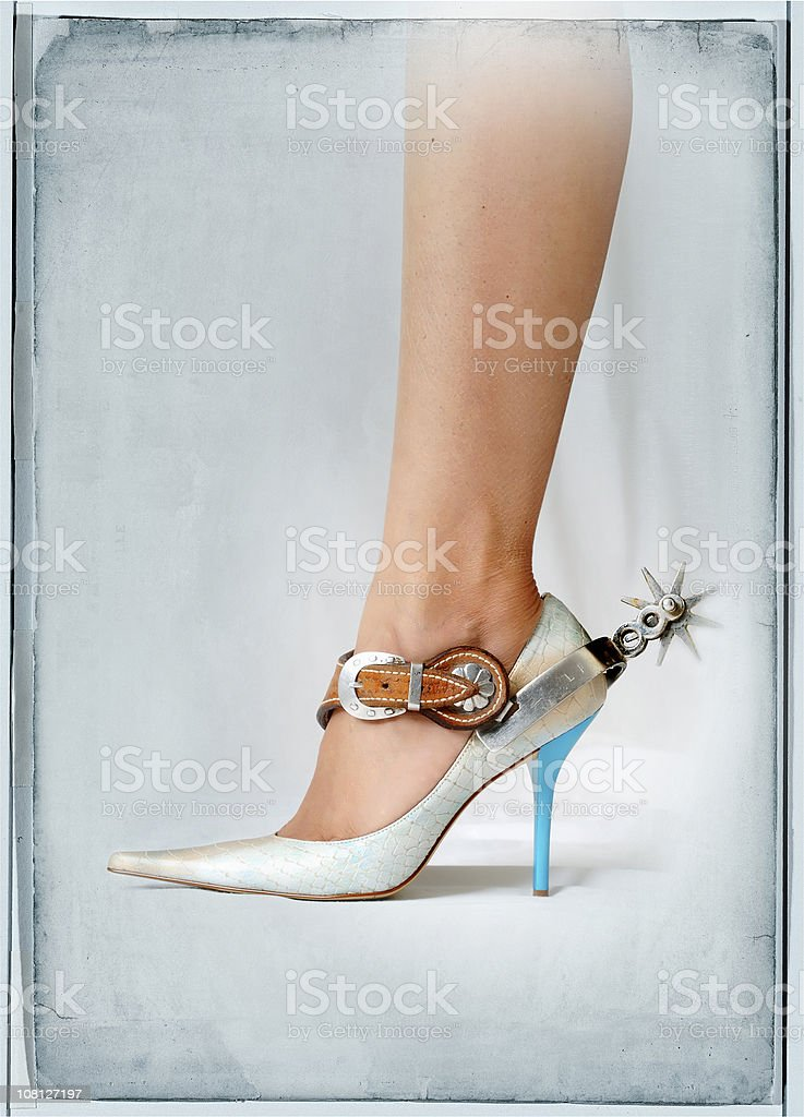 spur on high heels stock photo
