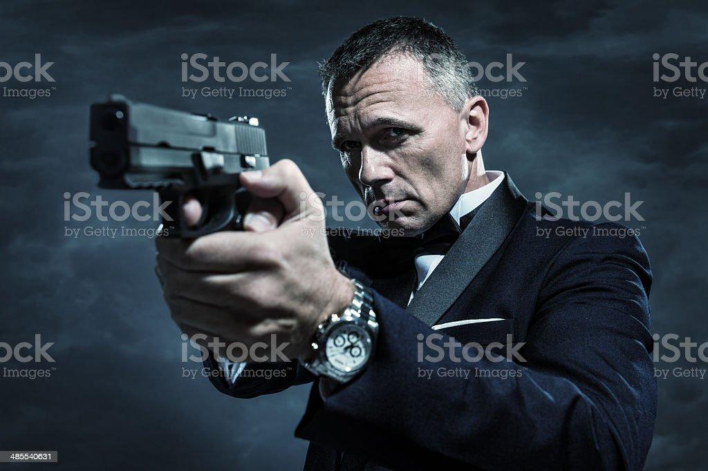 Spy in Tuxedo Aiming Gun stock photo