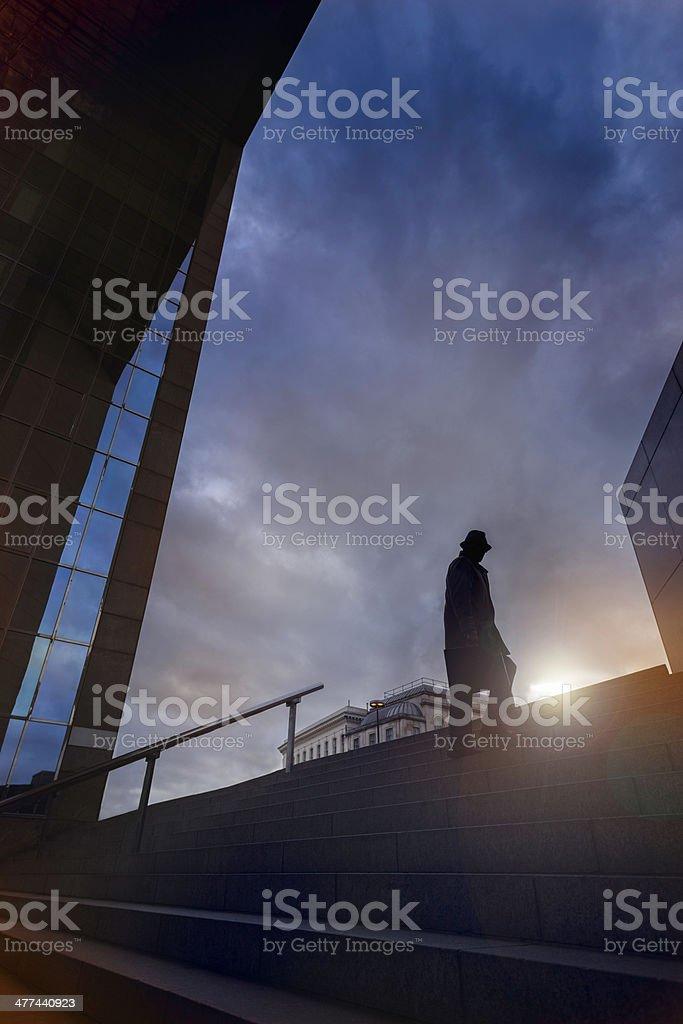 Spy sillhouette on steps stock photo