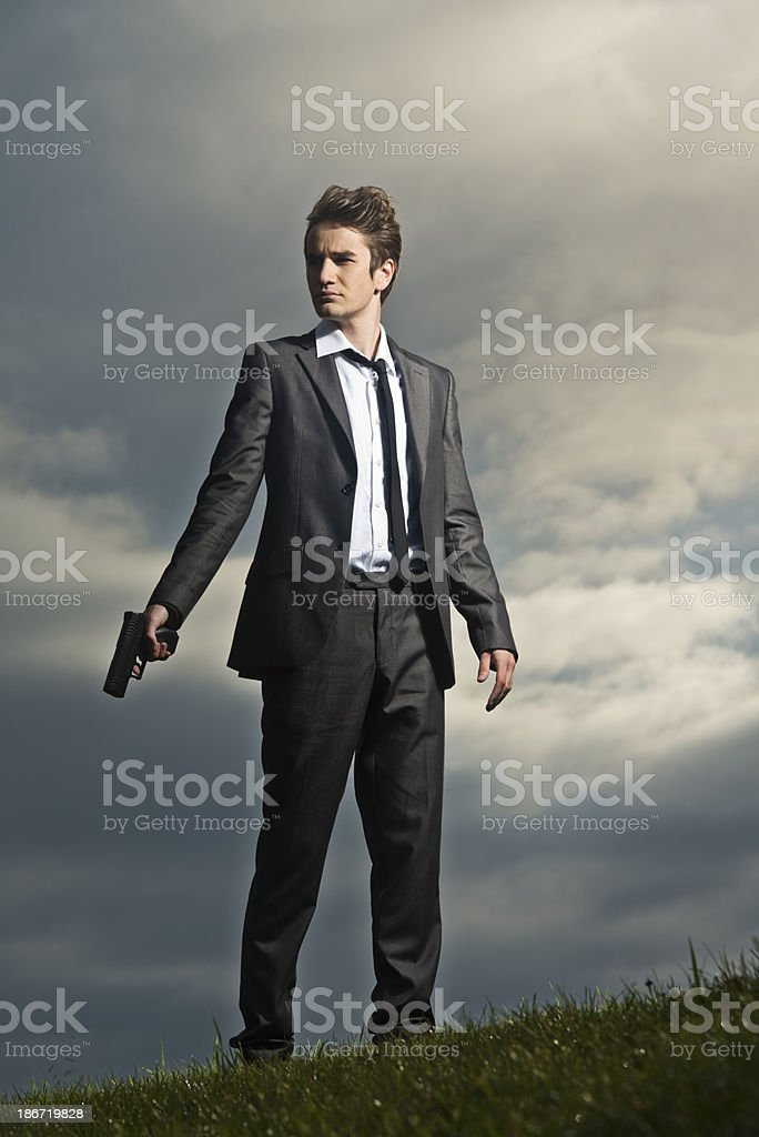 Spy with a gun royalty-free stock photo