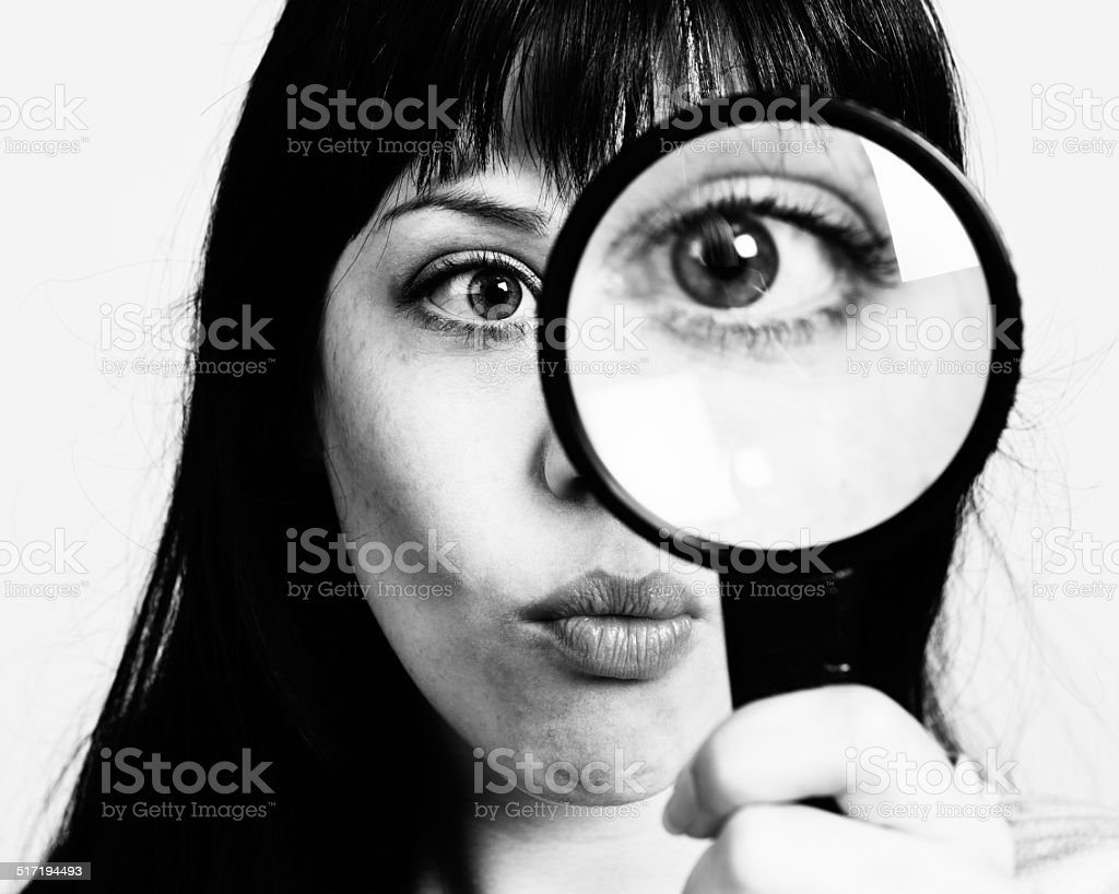 I spy with my big eye! Woman with magnifying glass. stock photo