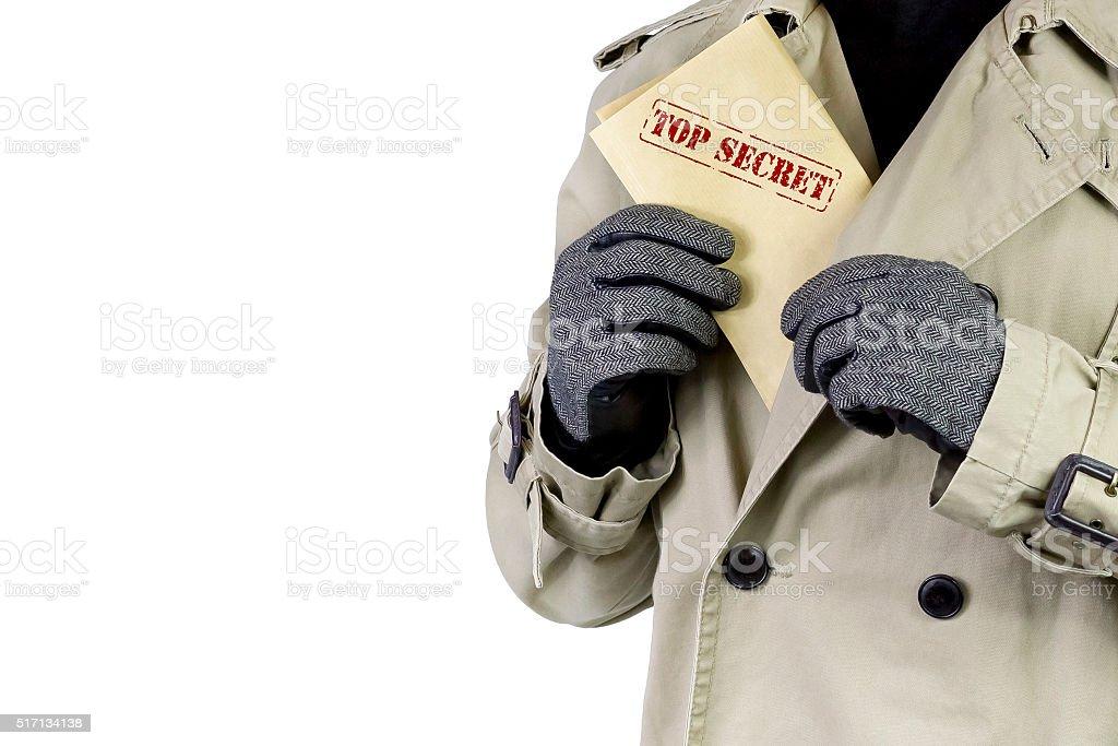Spy with top secret documents. stock photo