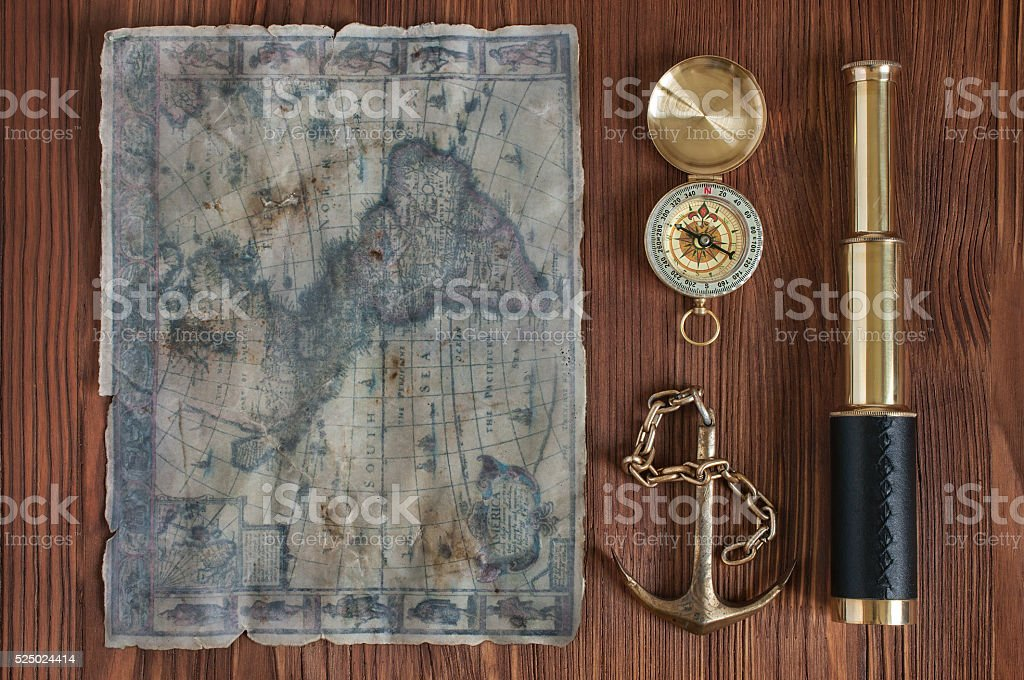 Spyglass, compass, anchor and old map stock photo