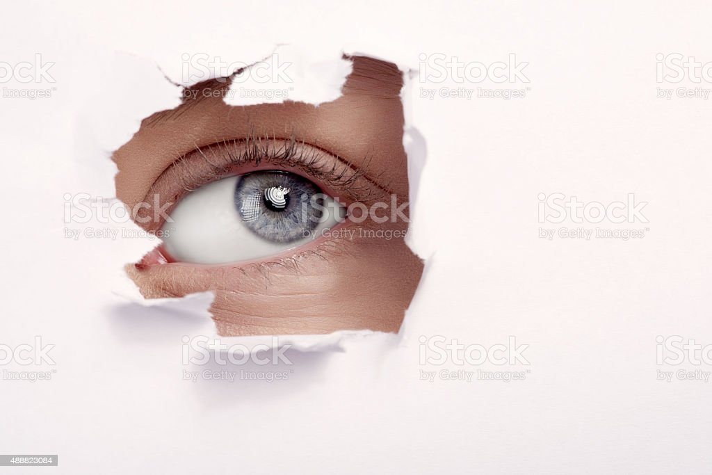 spying and hiding eye stock photo