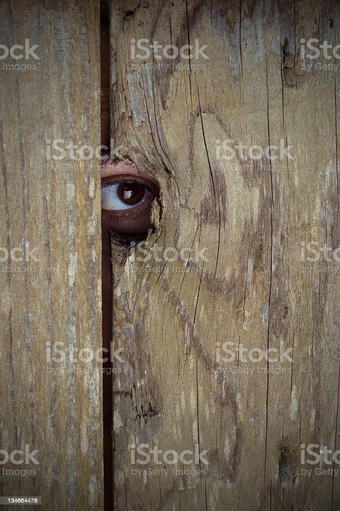 Spying on people through peephole, copy space stock photo