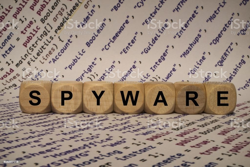 spyware - cube with letters and words from the computer, software, internet categories, wooden cubes stock photo