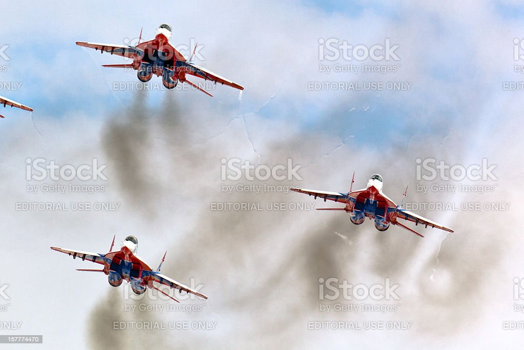 Squad of russian fighters Mig-29 flying in formation royalty-free stock photo