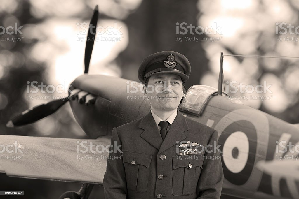WWII Squadron Leader in front of Spitfire stock photo