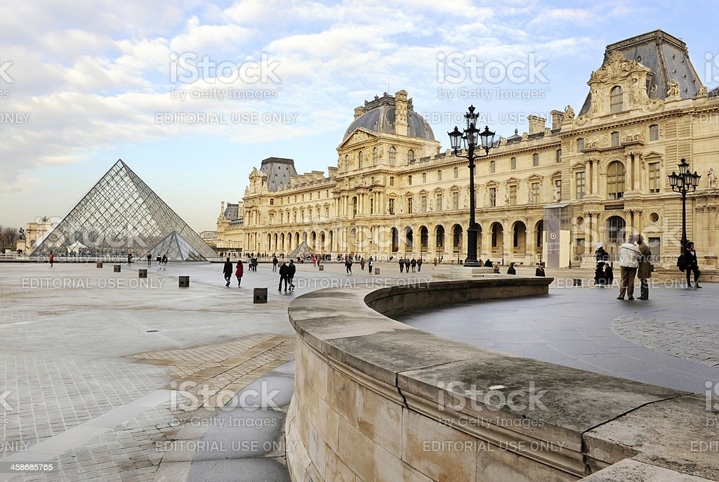 Square and pyramid in front of the Louvre Museum stock photo