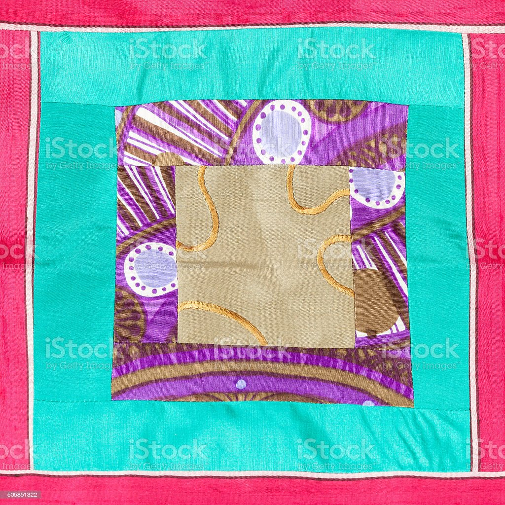 square applique of patchwork cloth stock photo