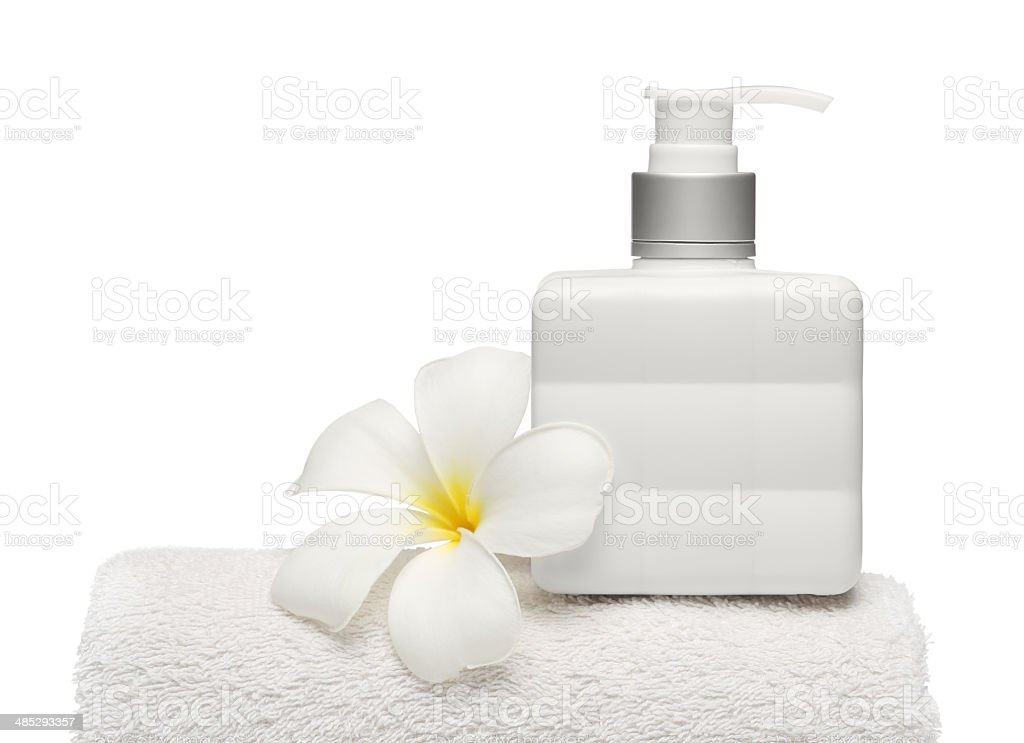 square bottle soap and flower on white towel white background royalty-free stock photo