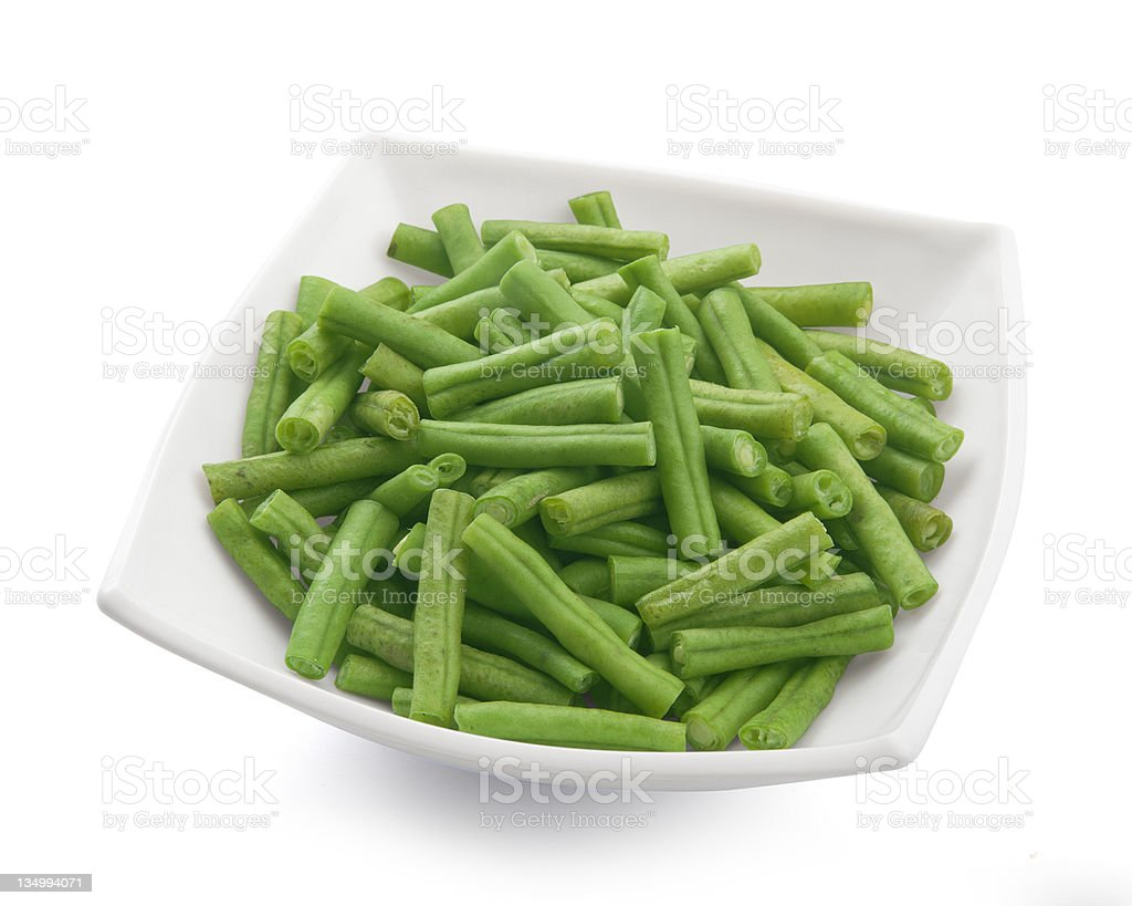 A square bowl of peas in the pod stock photo