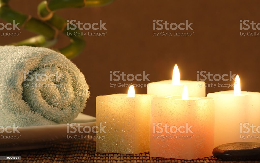 square candle and towel before bamboo stock photo