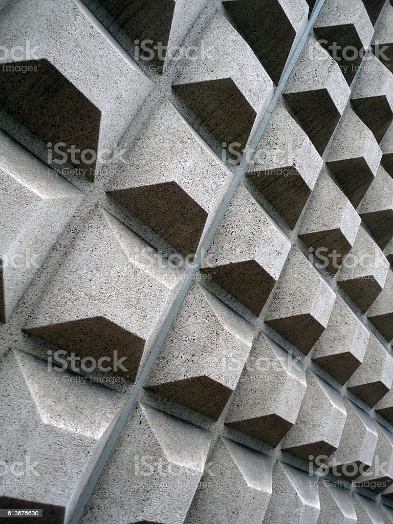 Square concret shapes project out of side wall stock photo