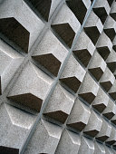 Square concret shapes project out of side wall