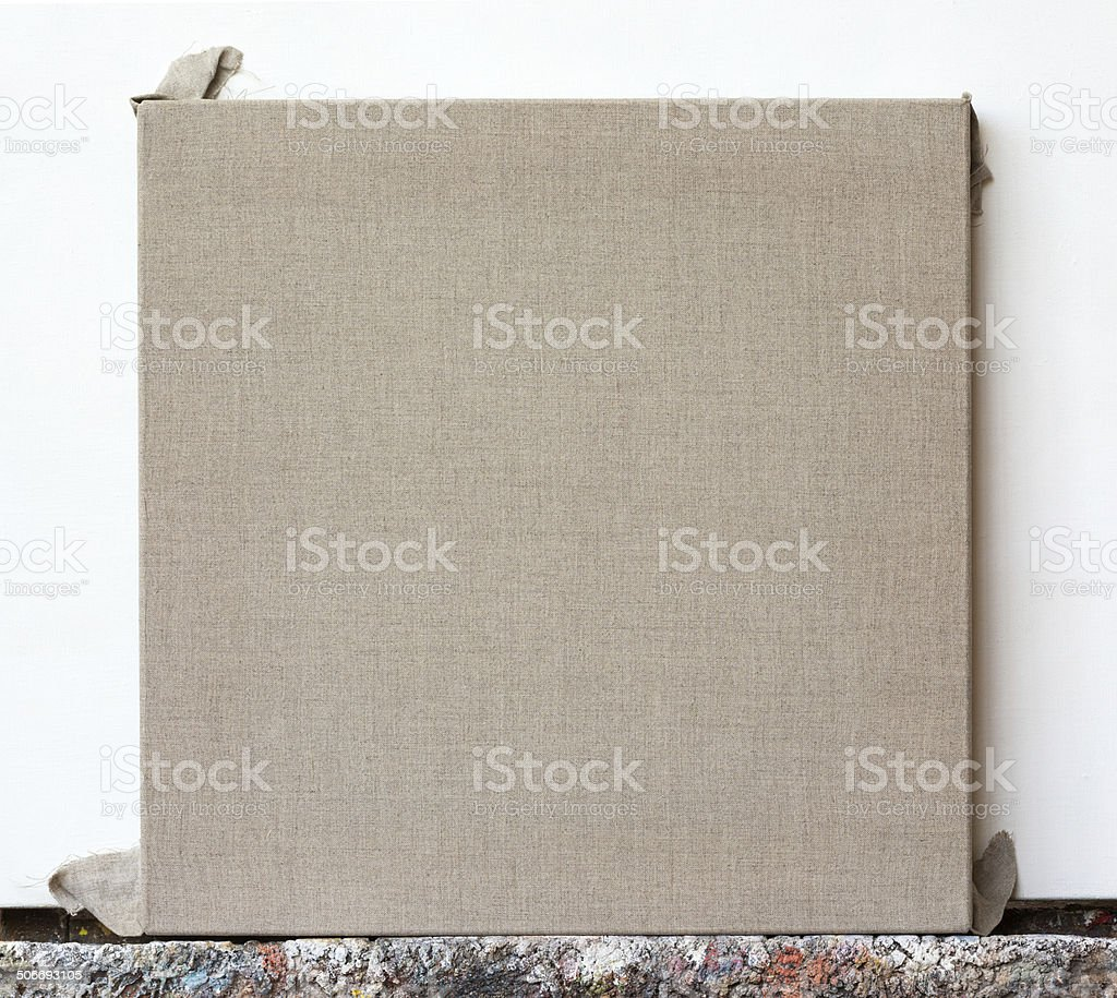 Square formate unprimed linen canvas on the easel stock photo