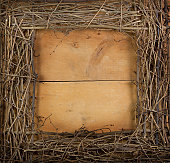 Square grapevine wreath on a wooden background