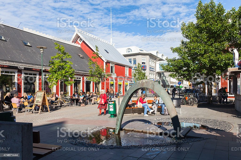 Square in Reykjavik with a fountain and outdoor cafes stock photo