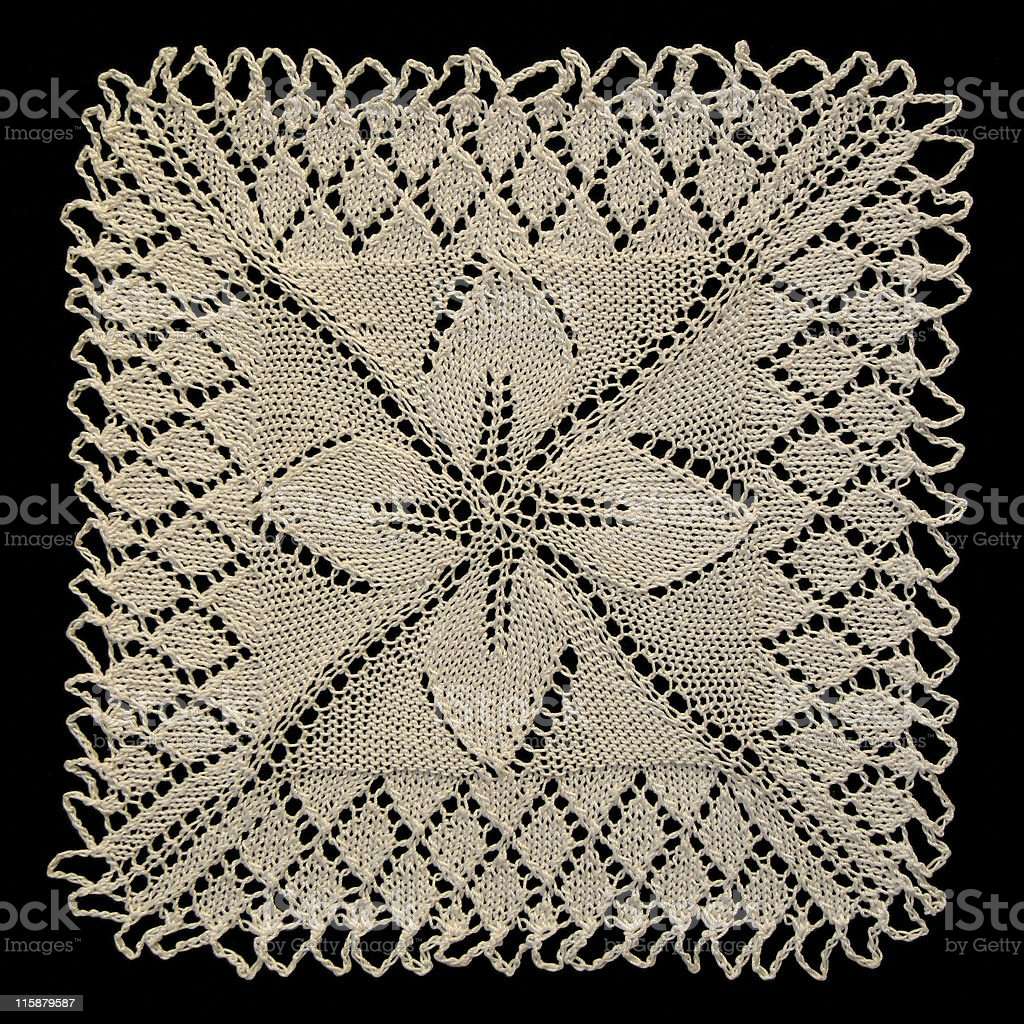 square knitted doily stock photo