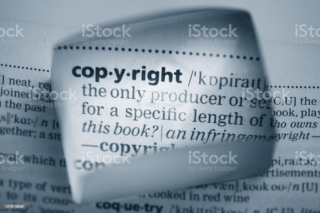 A square magnifier showing the definition of copyright royalty-free stock photo